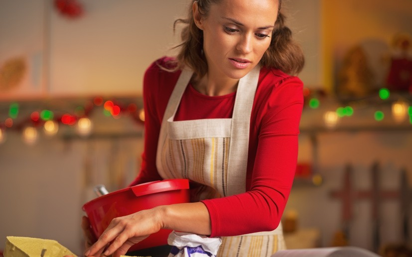 Young housewife preparing christmas dinner in kitchen