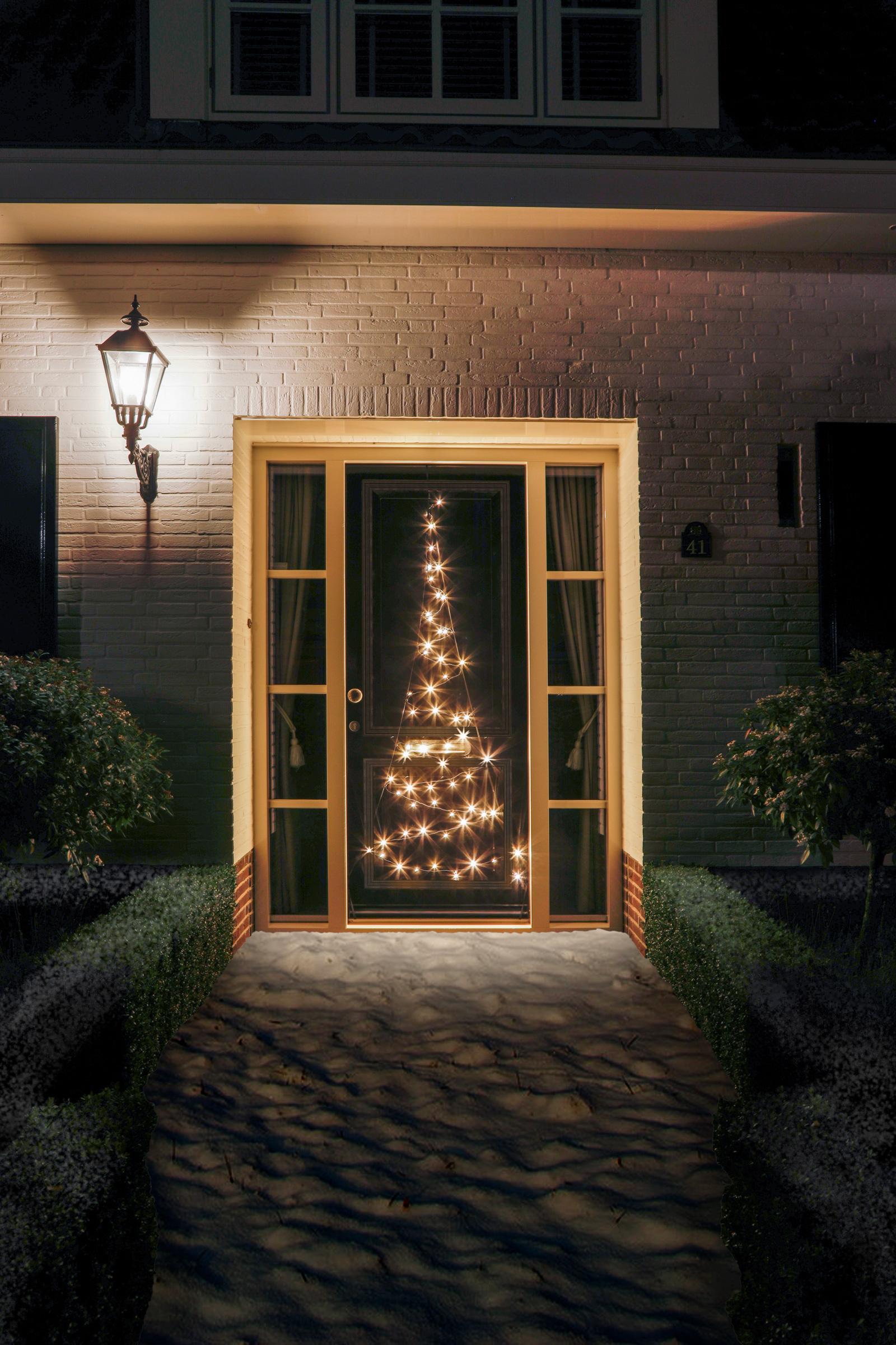 kerstverlichting buiten inspiratie 5 een kerstboom struik of loofboom verlichten