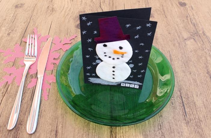 sneeuwpop van wattenschijfjes bord